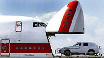 A Porsche Cayenne is loaded into an airplane for export to the USA