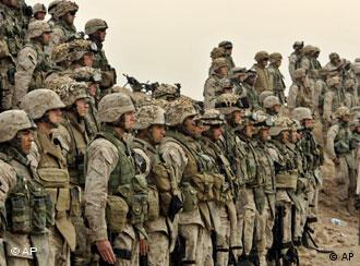US Marines of the 1st Division line up for a prayer at their base outside Fallujah, Iraq