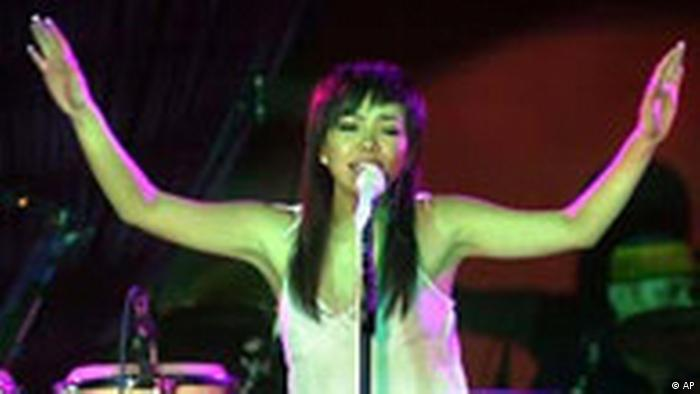 Asian pop diva from Taiwan, A-mei, sings to an excited audience during a benefit show, Thursday, July 22, 2004, in Taipei, Taiwan. Known for importing its pop music from Japan, America and Europe as early as the 1920's, Taiwan has nurtured a large number of Taiwanese composers, lyricists, stage artists and video producers. They have formed the backbone of a big music industry that has successfully marketed the mega stars in Taiwan and throughout Asia. (AP Photo/Jerome Favre)