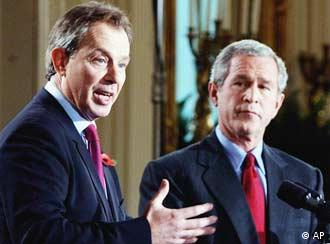 President Bush listens to British Prime Minister Tony Blair in 2004