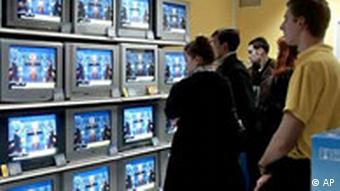 TV shop visitors watch the television debate between Viktor Yushchenko, a Western-leaning reformer, and Prime Minister Viktor Yanukovych