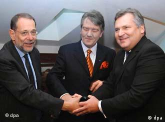 A threesome for Ukraine: Solana, Yushchenko and Kwasniewski