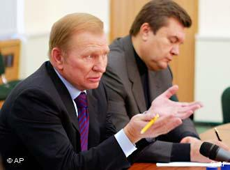 Kuchma, left, warned that Ukraine's economy is suffering from the crisis