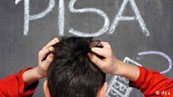 A boy holds his head in frustration, staring at a chalkboard with the word PISA written on it