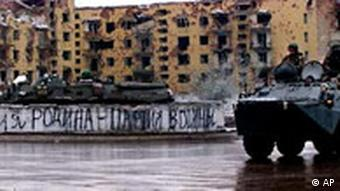 Russian troops sit atop an APC while patrolling in Grozny