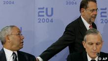 U.S. Secretary of State Colin Powell, left, reacts when being greeted by EU high representative Javier Solana, right, as Dutch Foreign Minister Ben Bot waits to start a press conference in The Hague Friday Dec. 10, 2004. Powell is meeting for two hours of talks with the Dutch Foreign Minister who is representing the EU. The Dutch presidency runs till the end of the year. (AP Photo/Peter Dejong)