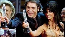 Spanish actor Javier Bardem, center shows off his 'Best European Actor' award alongside Spanish actress Penelope Cruz who won the 'People's Choice Best actress' award at the European Film Awards in Barcelona, Spain Saturday Dec. 11, 2004. (AP Photo/EFE, Alberto Estevez) ** SPAIN OUT **