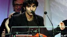 Turkish born Fatih Akin makes a speech after his film 'Head On' won the best film award at the European Film Awards in Barcelona, Spain Saturday Dec. 11, 2004. (AP Photo/Pool)