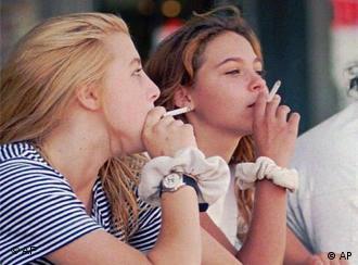 Teenage girls smoking cigarettes