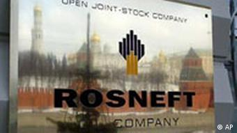 Rosneft sign reflecting Moscow skyline