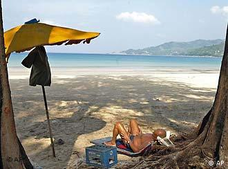 On Thailand's Patong Beach, tourism goes on