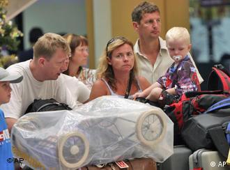 Swedish tourists in Phuket wait to take a flight back home