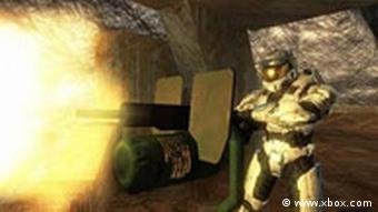 A screen shot of the computer game Halo, in which a character is shooting a gun