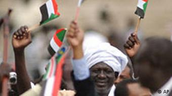 Southern Sudanese waving flags and celebrating the signature of the Comprehensive Peace Agreement