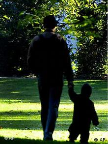 Man walking with child in park