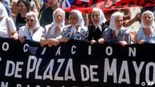 Members of the human rights group Mothers of Plaza de Mayo, march Saturday, Dec. 20, 2003 in Buenos Aires, with other demonstrators who lost their jobs during the country's economic crisis nearly two years after deadly riots erupted over the country's financial woes. (AP Photo/Daniel Luna)