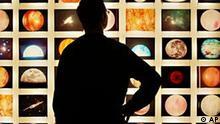 Ein Besucher schaut in Stanley Kubricks Universum fuer den Film A Space Odyssey bei der Pressevorbesichtigung der Ausstellung Stanley Kubrick in Berlin am Mittwoch, 19. Januar 2005. Hunderte von Objekten illustrieren die sonderbare Welt des legendaeren Regissuers, der 1999 verstorben ist. Die Ausstellung oeffnet am 20. Januar 2005 und dauert bis zum 11. April 2005. (AP Photo/ Jan Bauer) --- A visitor looks at a display of director Stanley Kubrick's universe for his movie A Space Odyssey at the Stanley Kubrick exihibition in Berlin on Wednesday, Jan. 19, 2005. The exhibition shows original props and will run from Jan. 20 until April 11, 2005. (AP Photo/ Jan Bauer)