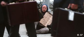 Bettler, Symbolbild Gegensatz zwischen arm und reich