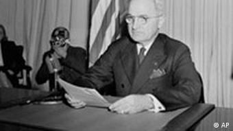 President Truman sits before a microphone, holding his speech, at the White House, Washington, DC, May 8, 1945, after he had finished reading his announcement to the nation that Allied Armies have won unconditional surrender from the German forces on all fronts. (AP Photo/stf)