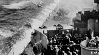 A Japanese kamikaze pilot tries to maneuver so as to crash on the deck of a U.S. warship somewhere in the Pacific in May 1945