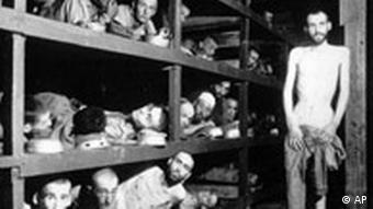 Men on bunk beds in the Nazi Buchenwald concentration camp, Elie Wiesel is pictured seventh from left in the middle bunk