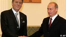President Vladimir Putin, right, greets Ukrainian President Viktor Yushchenko in the Kremlin in Moscow, Monday, Jan. 24, 2005. A day after taking office as Ukraine's president, Viktor Yushchenko arrived in Russia Monday to smooth relations with the Kremlin, which feared he would take his country out of Moscow's sphere of influence. (AP Photo/Mikhail Metzel)