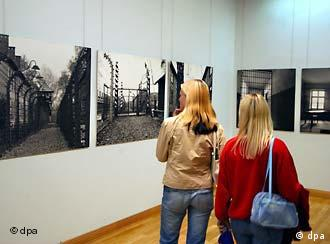 Two students view an exhibition on the Auschwitz concentration camp in Berlin in 2004