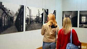 Two students visit an exhibition on the Auschwitz concentration camp in Berlin in 2004