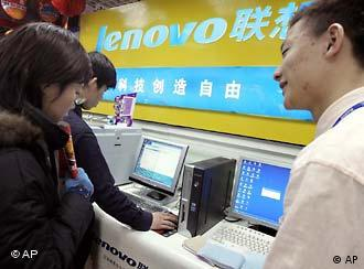 A Chinese salesman promotes Lenovo computers at a shop in Beijing, China, Friday, Jan 28, 2005. China's computer giant, Lenovo's deal to buy the personal computer division of IBM for a proposed US$1.75 billion is on hold pending a review by U.S. Committee on Foreign Investment after U.S. officials voice concerns over national security. (AP Photo/Ng Han Guan)