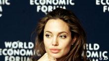 American actress and UN Goodwill Ambassador Angelina Jolie waits for the start of a media conference at the World Economic Forum in Davos, Switzerland, Saturday Jan. 29, 2005. (AP Photo/Michel Euler)