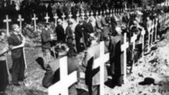 Crosses mark graves at a concentration camp