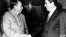 Chairman Mao Tse-tung, left, and U.S. President Richard Nixon shake hands as they meet in China in Feb. 1972. Nixon's visit, Feb. 21-28, marks the first U.S. presidential visit to the People's Republic of China. (AP Photo)
