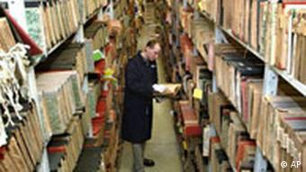 A worker checks files at the National Rememberance Institute archive in Warsaw, taken on Tuesday, Jan. 25, 2005. The Institute keeps files of the communist era secret police informers and their targets. (AP Photo/Alik Keplicz)