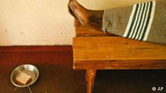 The feet of an AIDS-positive person on a wooden bed in South Africa