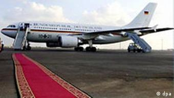 A German government plane with an empty red carpet in front of it