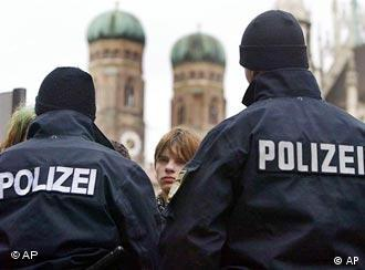 Police officers with Munich's Marienplatz towers in the background