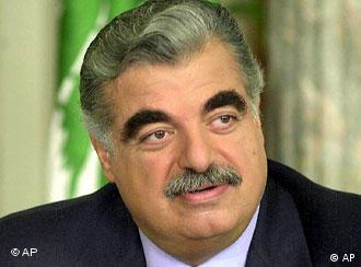 * FILE ** Lebanese Prime Minister Rafik Hariri is seen in this April 19, 2001 file photo. Hariri was Monday, Feb. 14, 2005 killed in a massive bomb explosion that ravaged his motorcade on Beirut's famed seafront corniche Monday, a Cabinet minister said. (AP Photo/Al-Mostaqbal, Nabil Ismail)