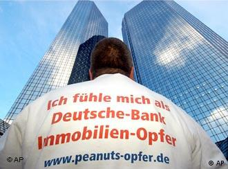Protester at Deutsche Bank, where 20,000 have lost jobs in three years