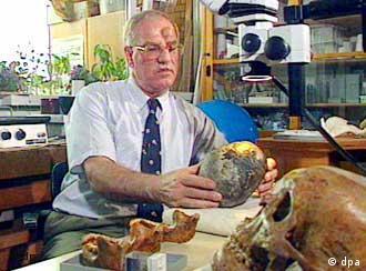 Reiner Protsch von Zieten showing off some of his skulls