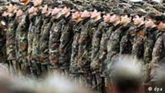 A row of soldiers stand at attention