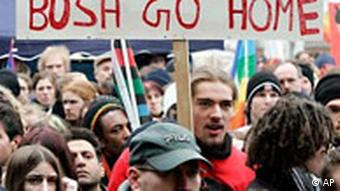 Anti-Bush demonstrators in Germany with a sign reading Bush Go Home