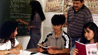 A Turkish teacher stands behind several students