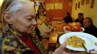 An older person in a soup kitchen