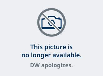 Miriyani holds up a photo of herself from her days in the underbelly of Indonesia
