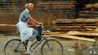 A female resident of Villa Baviera rides a bike in the compound in 2005