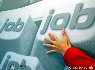 Hand reaching for 'job' sign