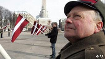 Men hold Latvian flags