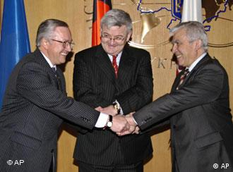 German Foreign Minister Joschka Fischer, centre, greets his Polish counterpart Adam Daniel Rotfeld, right and Ukrainian Foreign Minister Borys Tarasyuk during their meeting in Kiev, Ukraine March 21, 2005. Fischer and Rotfeld arrived in Ukraine on Monday on a brief visit for talks with the Ukrainian leadership. (AP Photo/Sergei Chuzavkov)
