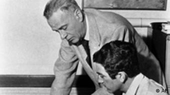 Marshall McLuhan, left, works with an adult learner in a workshop