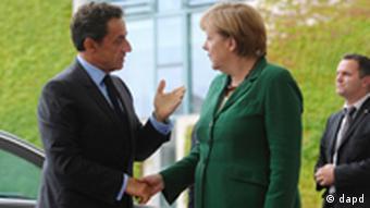 French Prime Minister Nicolas Sarkozy and Angela Merkel